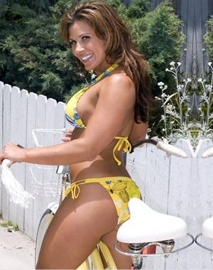 No bra for Mickie James, as she is wearing a bikini